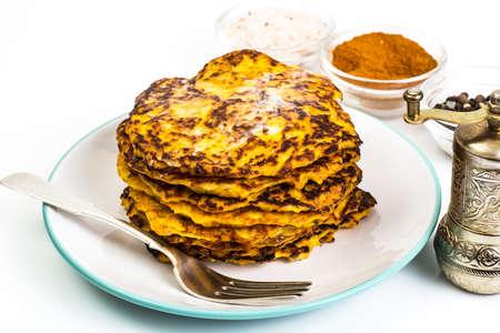 maslenitsa: Carrot orange Pancake with honey on white background Stock Photo