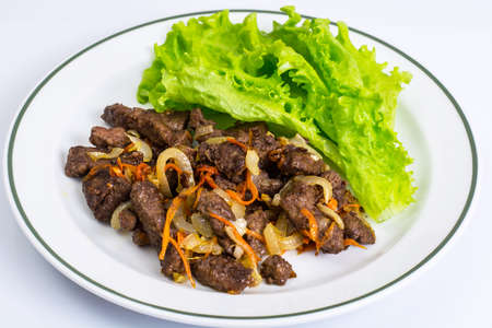 Calfs liver with letucce garnish Stock Photo