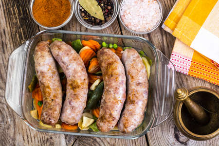 polish chicken: Country sausage with vegetables baked in the shape of glass