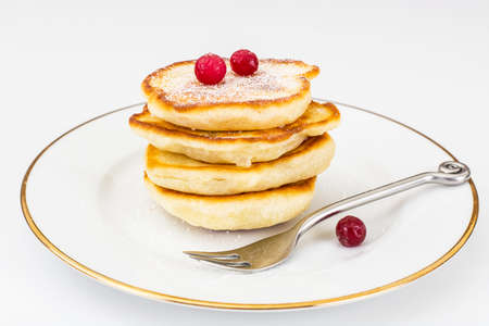 Delicious pancakes with berries and yogurt.