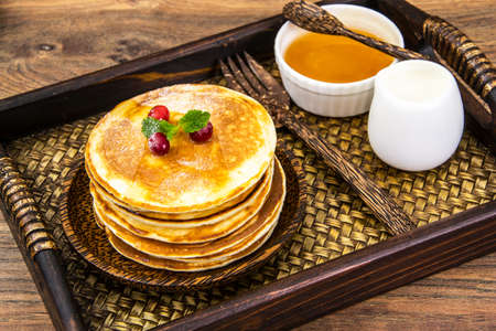 Tasty Pancake with cranberries and honey Stock Photo
