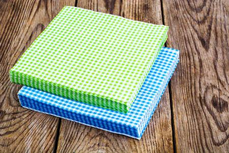 Serving Paper napkins on wooden background. Studio Photo