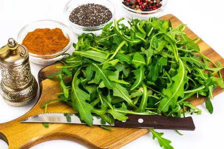 Arugula-ingredient salad on wooden Boards. Studio Photo Stock Photo
