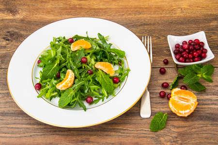 Vegetarian salad of arugula, mint, berries and Studio Photo