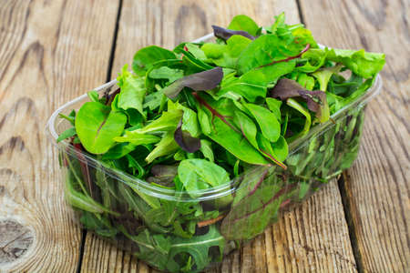Healthy eating of arugula, mitsuna, chard, red mustard in plasti Stock Photo