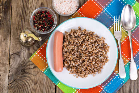 veal sausage: Sausage with garnish of buckwheat Stock Photo