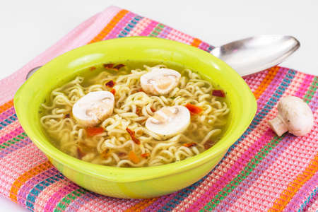 Soup from noodles with champignons Stock Photo
