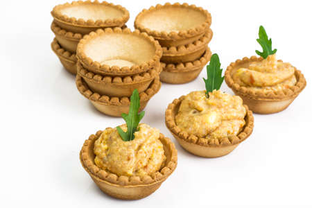 Portion appetizer of tartlets with fish paste Stock Photo