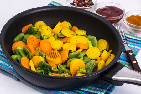 caper: Mix of roasted vegetables in pan
