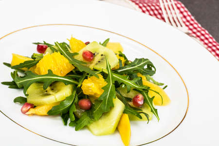 Fruit and vegetable salad with arugula Stock Photo