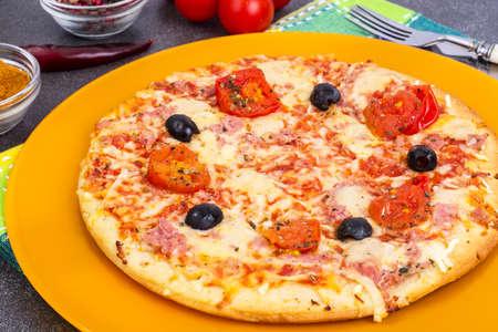 Homemade pizza with ham, cheese and mozzarella Stock Photo