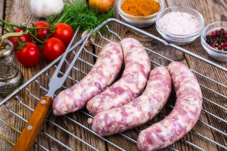 stuffing: Homemade sausages in a natural shell with spices on grill