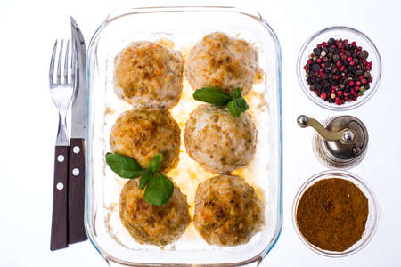 Grilled meatballs in  glass  frying pan. Studio Photo Stock Photo