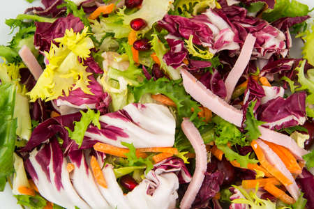 Mix salads with pomegranate and ham