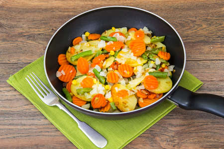 meatless: Food without meat:fried vegetables in frying pan