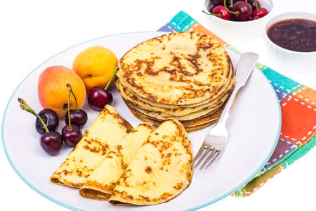 Large plate of fruit and pancakes. Studio Photo Stock Photo