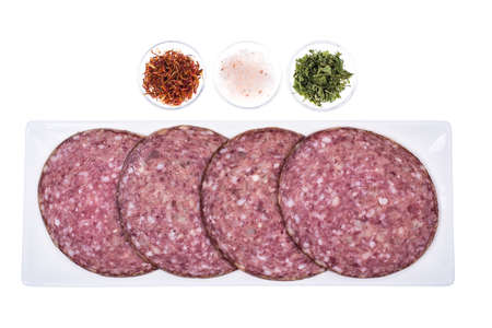 Round slices of chopped sausage on white background. Studio Photo