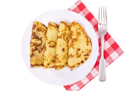 maslenitsa: Crispy thin pancakes on plate, light background. Studio Photo