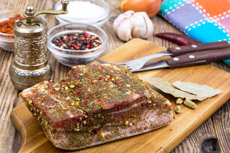 Salted pork bacon with spices on kitchen cutting board Stock fotó - 82096136