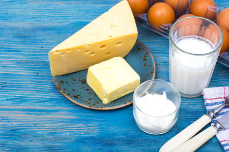 Dairy products as background of healthy food on blue