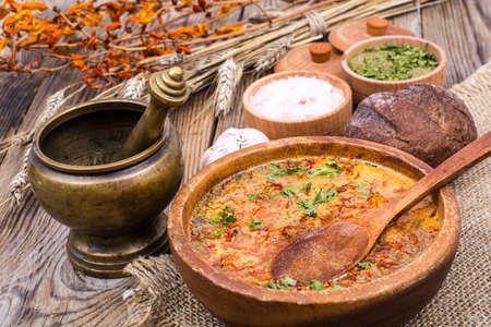 gazpacho: Village soup in wooden bowl on an old table Stock Photo