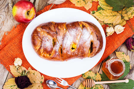 strudel: Roll with apples and raisins on Harvest holiday. Studio Photo Stock Photo