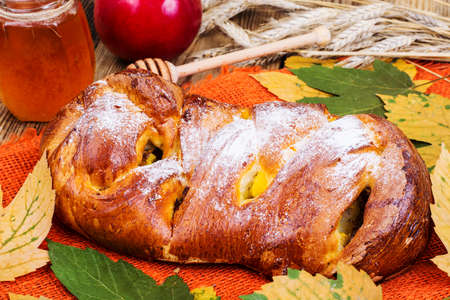 Roll with apples and raisins on Harvest holiday. Studio Photo Stock Photo
