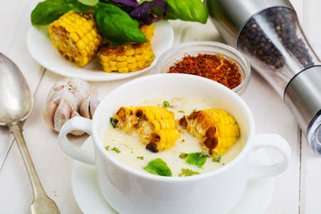 Cream soup with slices of corn grill