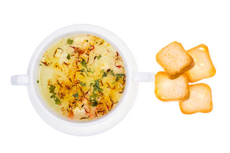 olive green: Vegetable soup with saffron in white bowl