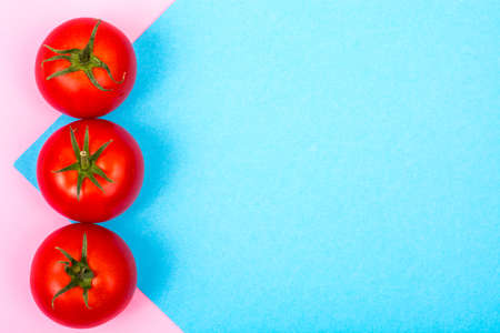 Pastel bright background with red tomatoes Stock Photo