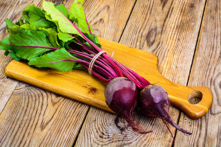 Fresh raw beetroot, sliced on kitchen cutting board Stock Photo