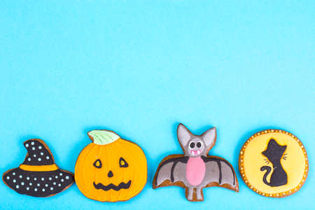 Halloween gingerbread on bright pastel color Stock Photo