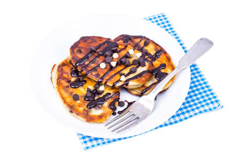 Fritters with chocolate on white plate