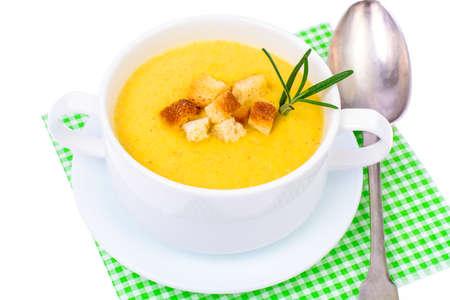Tasty pumpkin puree soup in white soup tureen