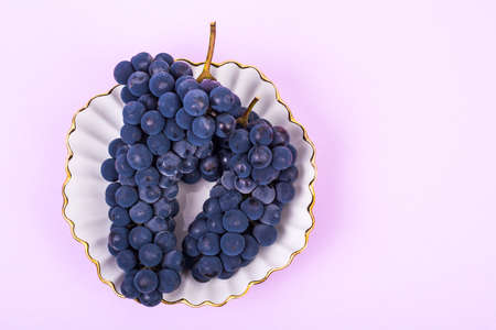 Bunch of blue ripe sweet grapes