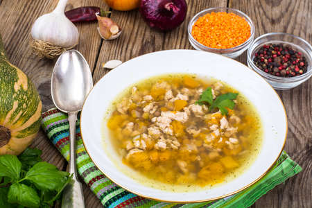 Spicy chicken soup with lentils and pumpkin