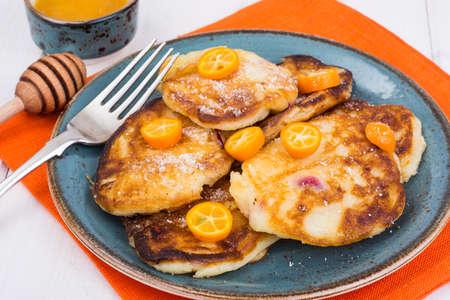 Sweet pancakes with fruit on white tree Stock Photo