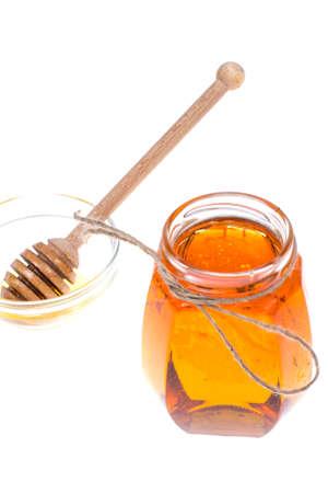 Bank of fresh, transparent honey, isolated on white background