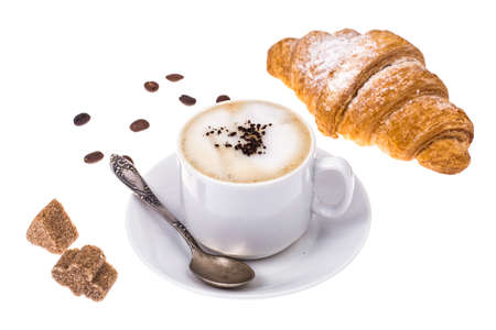 Fresh croissant and cappuccino on white background Stock Photo