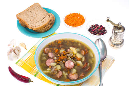 Dish from lentils, vegetables and sausages Stock Photo