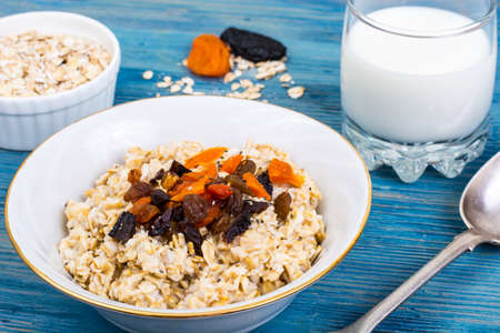 Porridge of oatmeal with dried fruits and chia seeds