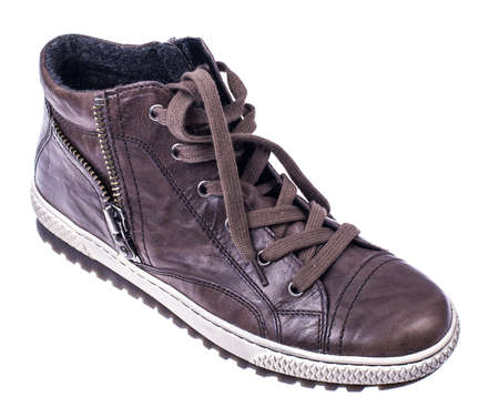 Brown womens boots with laces on white soles Stock Photo