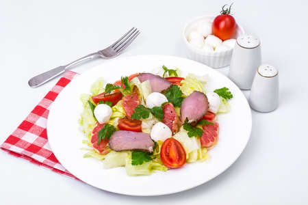 fresh vegetable salad with ham and mozzarella