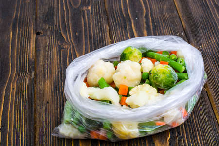 Frozen mixt of vegetables with Brussels and cauliflower, carrots, peas and beans Stock Photo