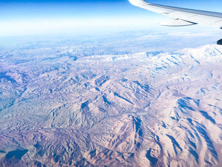 Mountains in the airplane window