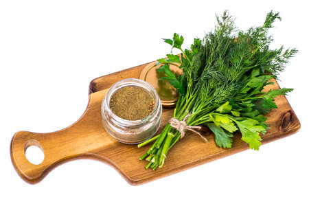 Fresh and dried garden greens of dill and parsley Stock Photo