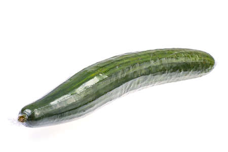 Fresh cucumber in package on white background. Studio Photo