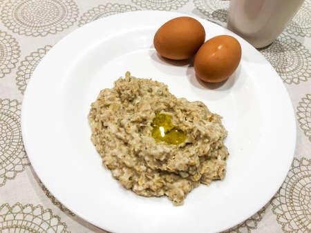 Porridge from oatmeal, eggs, tea. Studio Photo