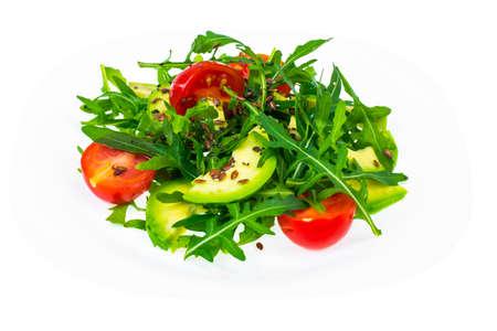 Light dietary salad from arugula, avocado, tomates and flax seed