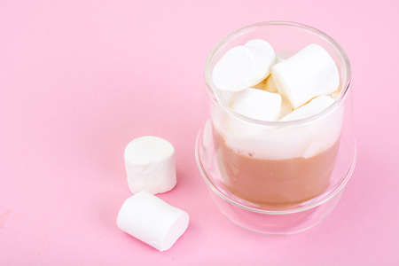 White marshmallow on pink background Stock Photo
